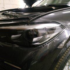 Оклейка фар BMW X5 полиуретаном SunTek