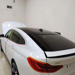 Покрытие крыши BMW X6 GT черным винилом